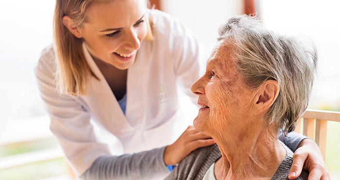Nurse with senior community resident