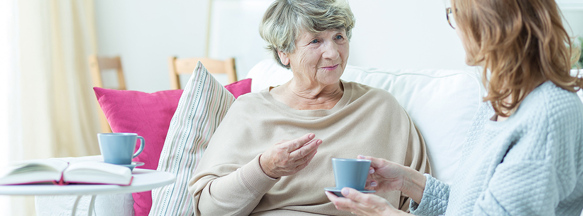 Senior woman talking to younger woman