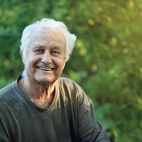 Senior man outdoors, smiling