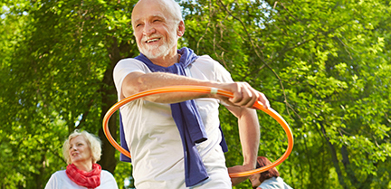 Senior man outdoors hoola hooping